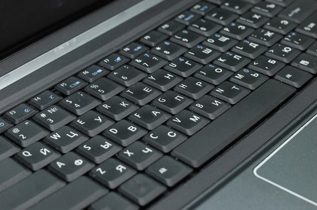 closeup of black notebook keyboard