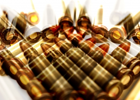 abstract background of AK-47 (7.62 mm) cartridges photo