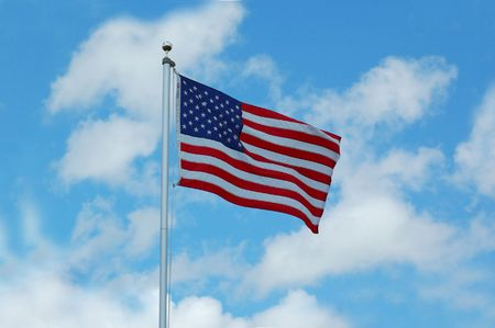 Full American Flag flying in the wind, with blue sky and clouds behind it Stock Photo - 5200581