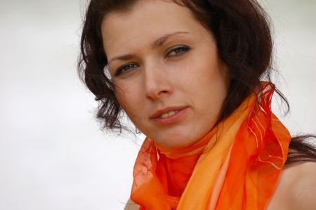 pretty brown-haired typical russian girl with orange scarf