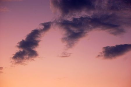 night is falling - violet and pink sky and clouds background Stock Photo - 5501092