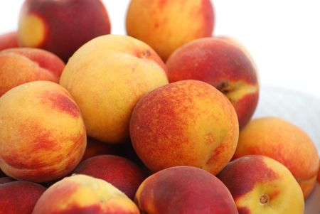 heap of peaches on plate photo