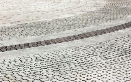 footway: arc pavement of square bricks background