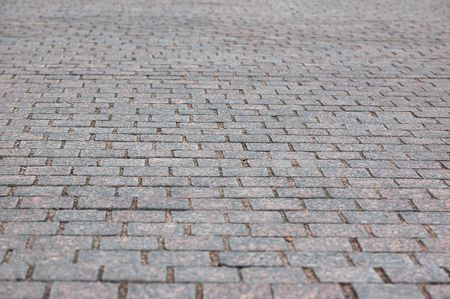 footway: aged pavement of square bricks background Stock Photo