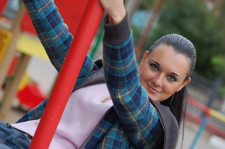 russian pretty long haired green-eyed  brunette on playground Stock Photo - 5637740