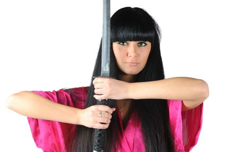 pretty brunette-ninja in red kimono holding samurai sword isolated on white photo