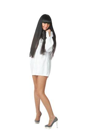 pretty bare-legged raven haired girl in short white shirt isolated on white photo