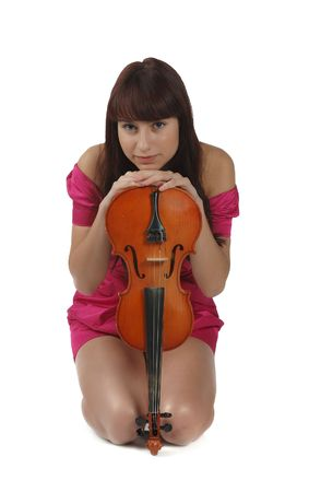 violon and pretty brunette girl in red dress sitting isolated photo
