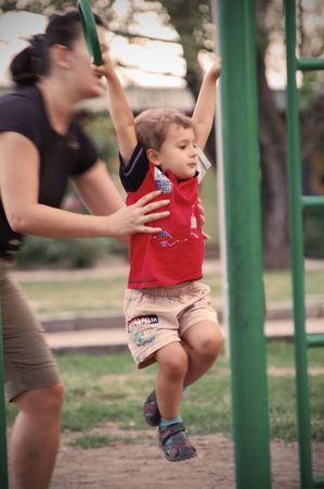 boy having exercise on play ground  photo