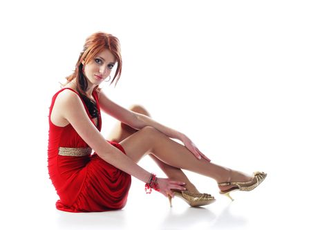 cute young pretty girl in red dress with gold belt Stock Photo - 6437184