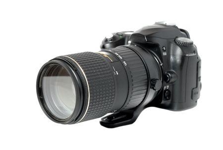 pro digital camera with big lens isolated on white photo