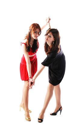 two cute young pretty girls in stylish dresses photo