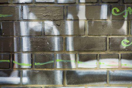 bg of brick wall with graffiti