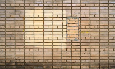 repaired: old repaired brick wall Stock Photo