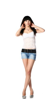 young black haired girl wearing a jeans shorts and top isolated on white photo