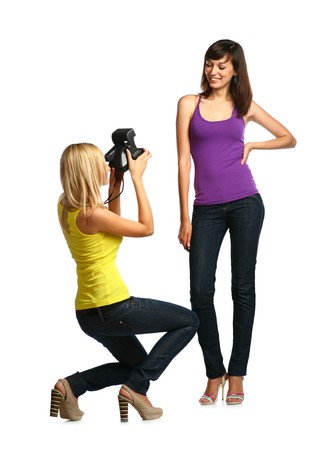 photographing - two girls make own snapshots isolated on white photo
