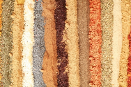 multi colored background of different oriental spices photo
