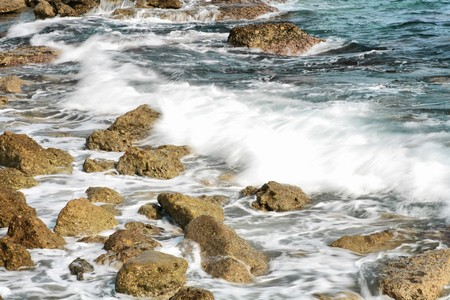 The rock on seashore with water and coming wave (HDR, long exposure) photo