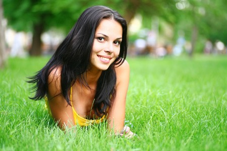 lawn care: sexy brunette on grass