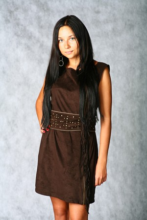 sexy brunette in brown dress on gray background Stock Photo - 7971616