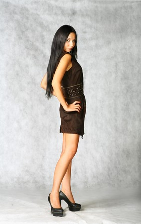 sexy brunette in brown dress on gray background Stock Photo - 7971607