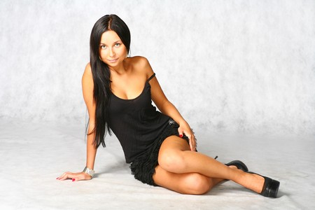 sexy brunette in black dress on the grey background Stock Photo - 7971649