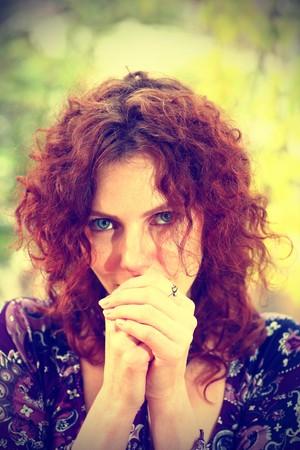 Portrait of a redheaded girl near a tree (split toning). photo