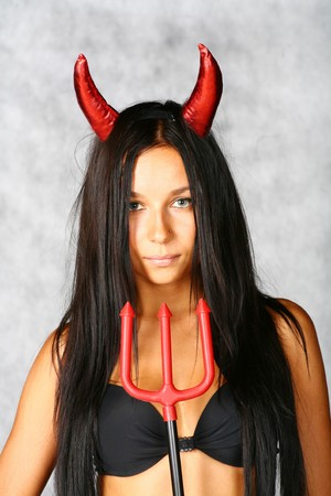 devil - girl with horns and red trident photo