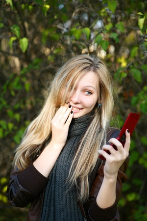 Young cute girl with long dark hairs. Fall. Autumn. Outdoor session. photo