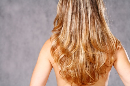 Young woman with long straight blond hair in studio on gray Stock Photo - 8425935