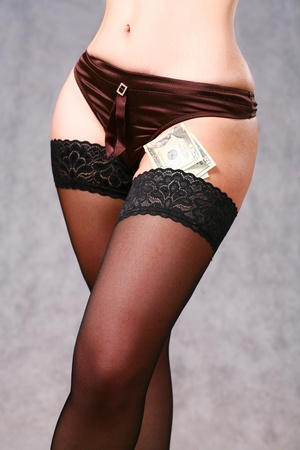 close up on a girl hipline with black panties and some dollar money around Stock Photo - 8425943
