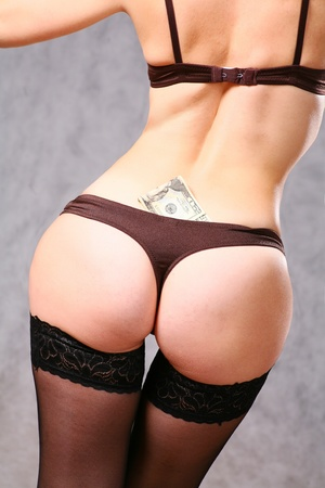close up on a girl ass with black panties and some dollar money around Stock Photo - 8425942