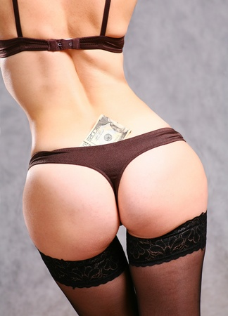 close up on a girl ass with black panties and some dollar money around Stock Photo - 8425937