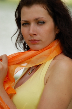 summer - beautiful female outdoors in the park in orange scarf photo