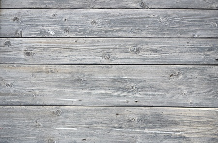A background of weathered gray painted wood photo