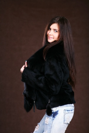 Beautiful Young Woman In A Fur Coat. photo