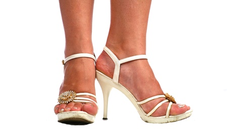 Woman legs with white high heel shoes over white Stock Photo - 9330911