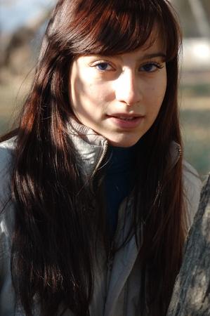 Portrait of beautyful woman in autumn outdoors photo