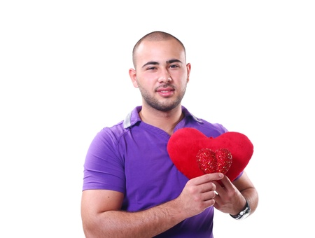 Happy young Latino guy smiling with twp red hearts in hands isolated on white photo