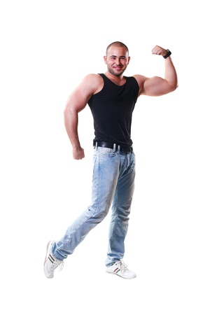 Latino sporty 20-25 years guy showing muscles isolated on white photo