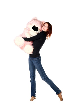 This is portrait of a beautiful redhead girl with Pink Bear on white photo