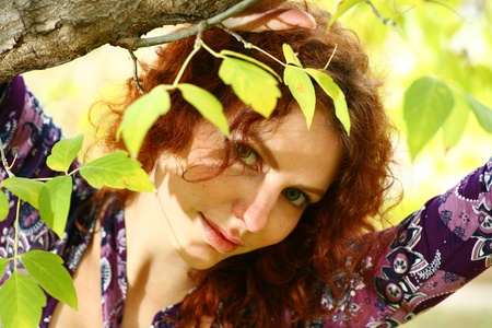 Portrait of a redheaded girl near a tree (autumn colors). photo
