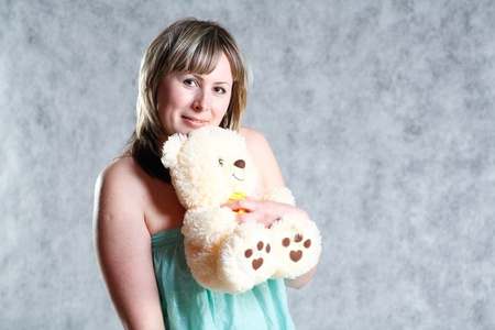 Sexy Blond Girl with teddy bear photo