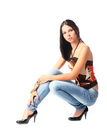 women in jeans sitting Stock Vector - 10199486