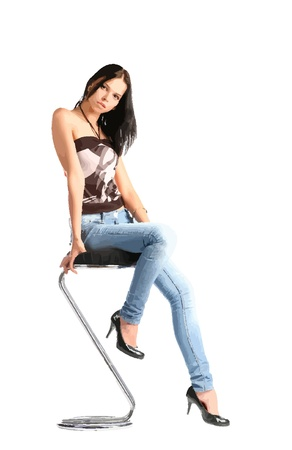 women in jeans sitting on the bar stool Vector