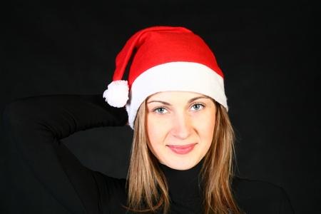mrs santa: Mrs. Santa dreaming about Christmas on dark background
