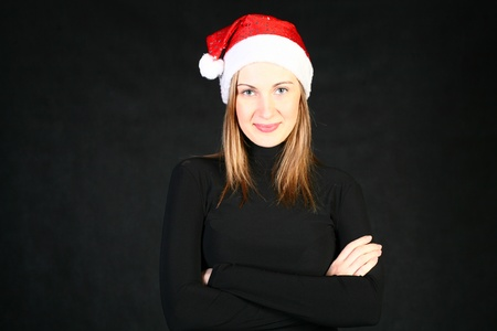 Mrs. Santa dreaming about Christmas on dark background photo