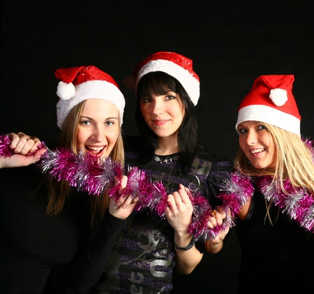four 20-25 years  women  friends having fun on a christmas party Stock Photo - 10419573