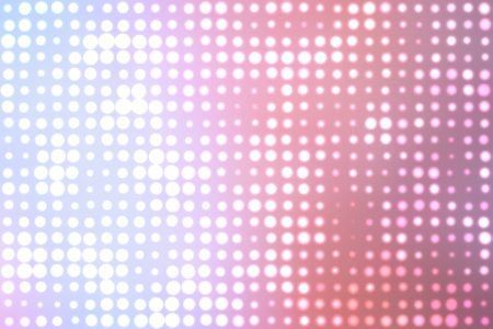 Dotted background of the colorful dots on the blured light photo