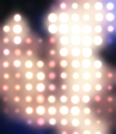 Dotted background of the colorful dots on the blurred light Stock Photo - 10493757